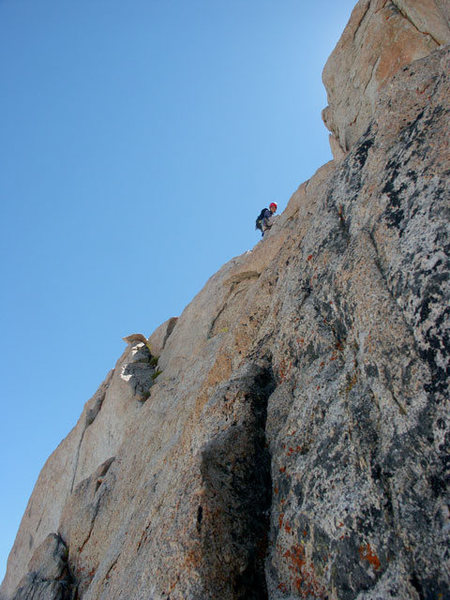 Etsuko is soloing the easy 5th pitch next to the 2nd tower on the East Buttress - July 24, 2004
