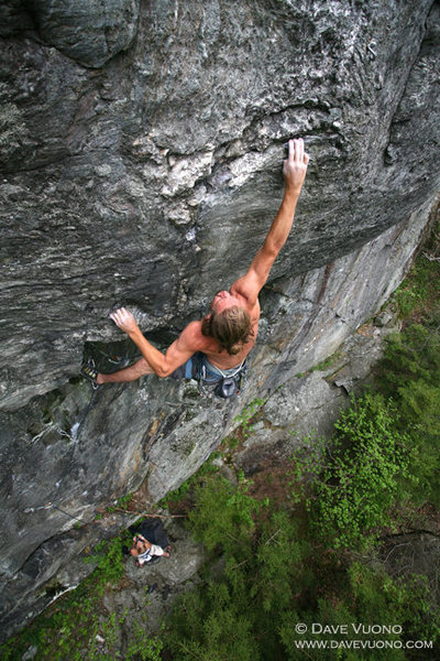 Kevin Ryan just barely sticking the crux of Who's your Daddy, 5.12d
