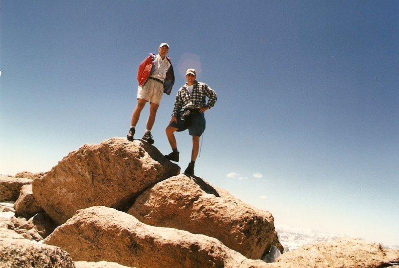 At the top of Long's Peak, ca 1998.  Really shoulda had crampons and an ice axe for self-arrest that day, but we stuck to our turnaround time anyway.  Great day.