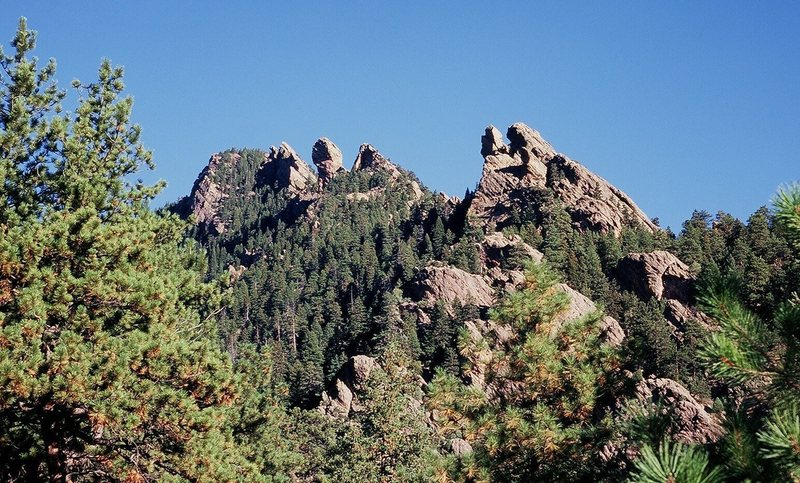 Shadow Canyon from the Mesa Trail at midmorning. The crags on the right-side skyline, from near to far, are:<br> Tower Of the Moon & Jamcrack Spire<br> The Pyramid<br> Devil's Thumb<br> West Face of Devil's Wings<br> Sunset Wall.<br> Photo by Tony Bubb, 11/07.