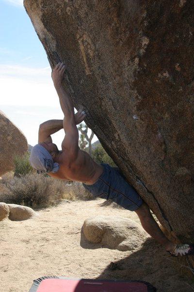 Mike reaching up to better holds on Picture Perfect Sit Start, V5
