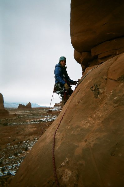 Matt starting pitch 2 and glad that he has his warm coat on.