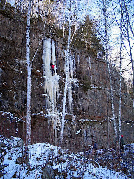 """Unknown climber on the """"advanced clinic route"""" during Sandstone Ice Fest 2006."""