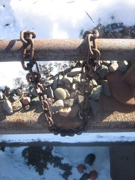 There are four sets of rusty chains atop the climbs.  A number of experienced climbers have recommended bringing your own equipment for use as top anchors.