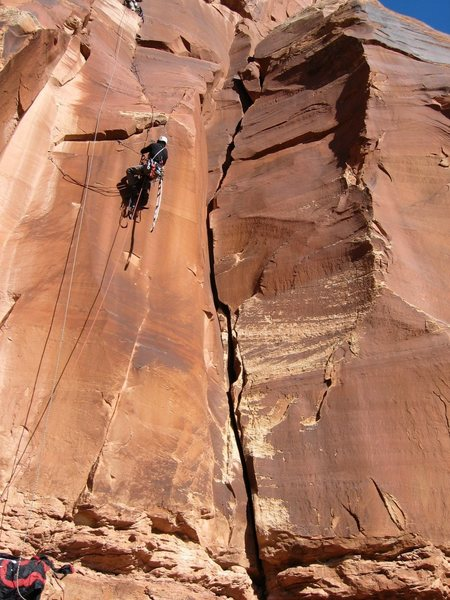 Route II is to the right of the person in the large looking crack.
