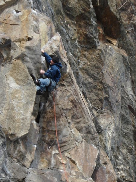 Brian sticking the fingerlock on the lower crux...nice work... First time sending the route and the weatherman said it was 17 degrees...