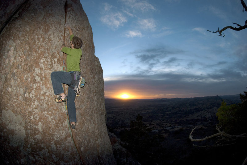 Jer Collins running laps on Dream Boat Annie as the sun goes down.  Mount Scott, WMWR, OK.