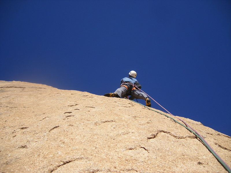 Looking for the first bolt on the run-out pitch to the summit.