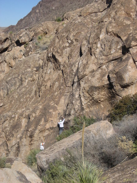 A climber top-roping the face just to the left of the crack. This face was highly friable, and is not recommended.