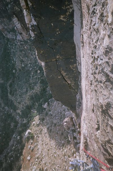 Looking down from the fourth belay station.  A semi-hanging belay which obviously has great exposure
