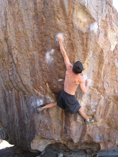 """The first of two crux moves, hitting the high 1/2"""" crimp.  This move is a bit reachy."""