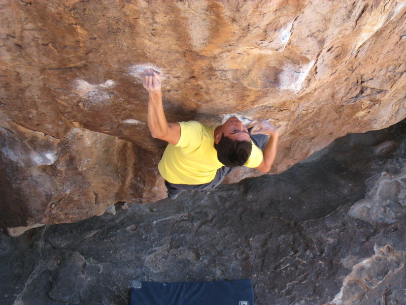 Once you hit the crimp, move the right hand to the lower of two pinches on the arete.  Sticking this pinch is probably the crux move.