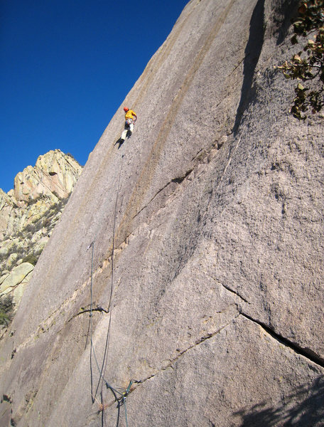 Enjoying a brief moment of relief after clipping the third of four bolts on the stellar 5.10 friction pitch on Tooth Or Consequences.