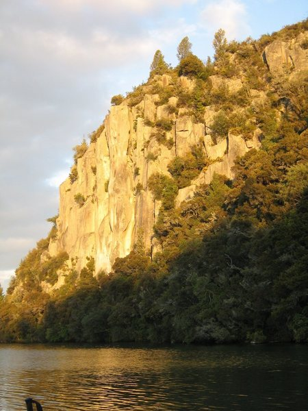 Whanganui Bay has some good trad lines.  The setting is really gorgeous as well. Its around Lake Taupo.  If you zoom in you can see me climbing up the cliff.