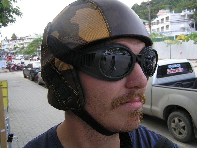 Me wearing a motorcycle helmet and goggles, rockin the 70's pornstar 'stache.