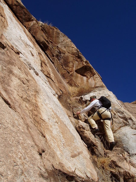 Start of Pitch 3. Dusty climbs toward two-tiered dihedral.
