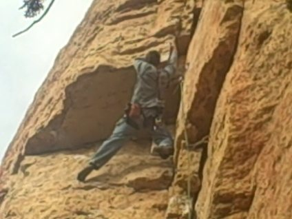 """Aaron pulling out of the """"Wadsworth Blvd. (5.10)"""" roof at Shelf Road Canon City, CO"""
