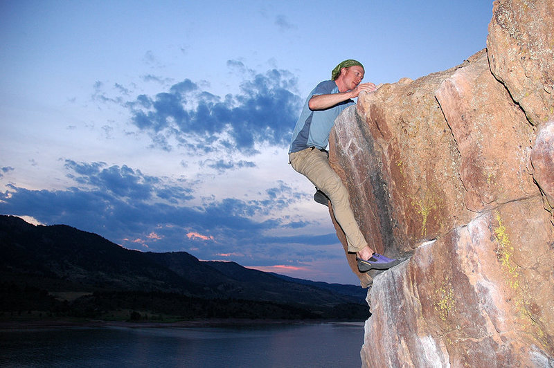Dylan tops out the Penny Pincher boulder at dusk - the best time to climb Rotary in the summer.