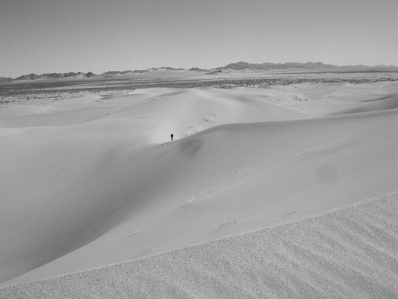 Exploring the peaceful Mojave desert 2/26/08.<br> <br> Jonny coming up the Cadiz dunes.