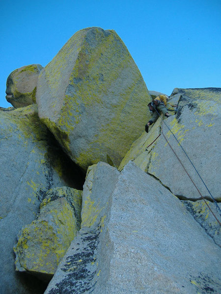 Mike Schneiter climbing the fourth pitch of Imaginary Voyage.
