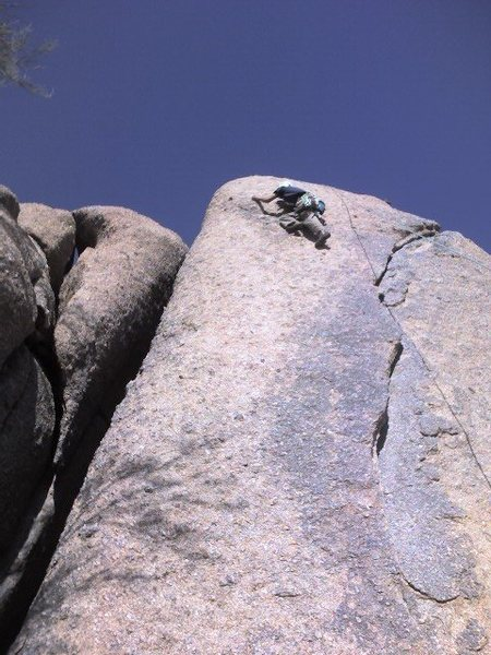 Preparing to step up and past the crux above the second bolt.
