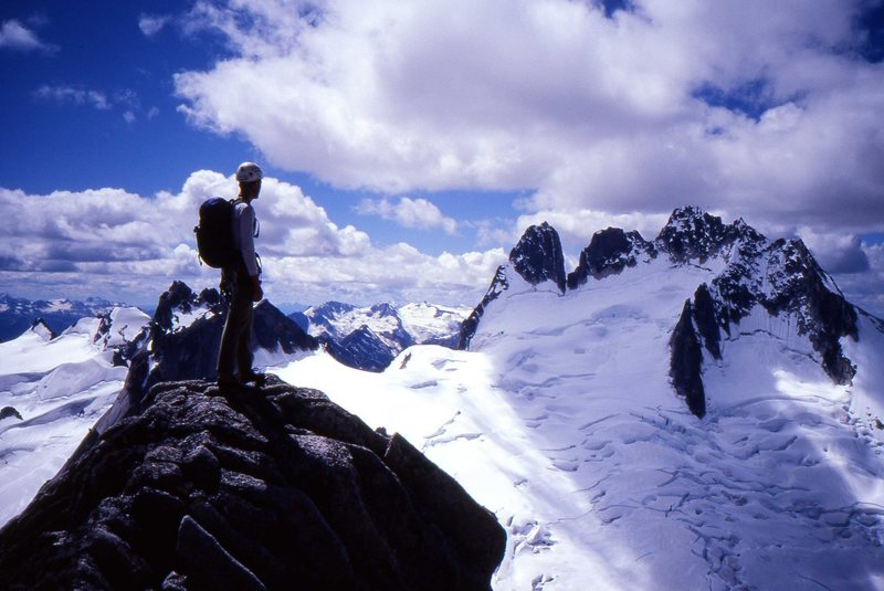 Kurt Johnson looking toward the Howser Towers from near the summit of Bugaboo Spire. Photo by Chad Bennett.