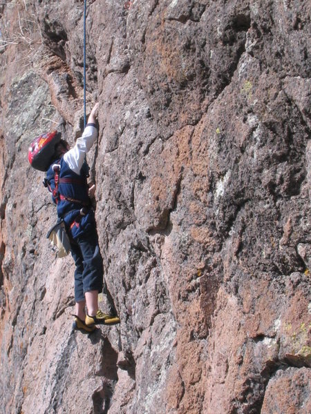 """Cody working through one of the cruxes on """"A La Verga"""" on the Cattle Call Wall at Las Conchas. March 23, 2008."""
