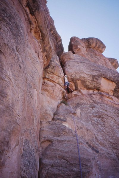 Charles Vernon in the crux at the top of pitch 2, Otto's Route.
