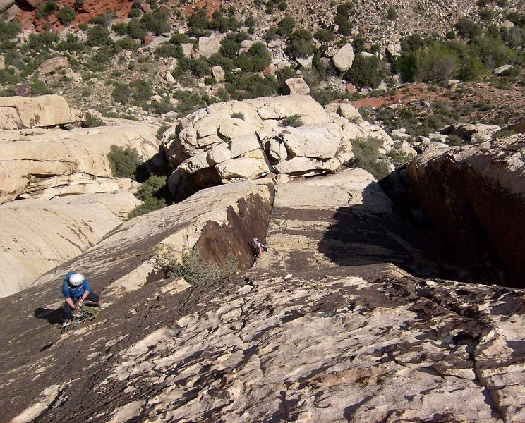 Looking down the varnished corner of pitch 4.  The belay at the top of pitch 4 is on the left.  This picture was taken from near the beginning of the fifth pitch, above the large overhang.