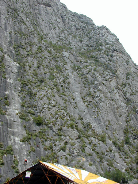 The route far left is Space Boyz. The route on the right with the roof just showing at the top of the photo is Black Cat Bone.
