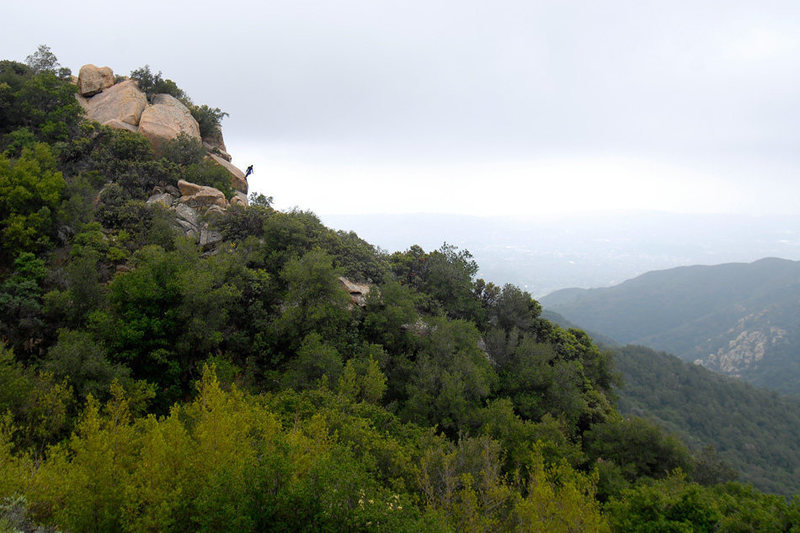 A climber hangs off the top of T-Crack, at Gibraltar Rock, as he belays his second.