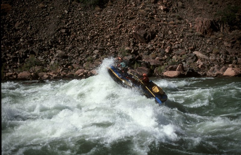 Sometimes just getting to the rocks is the adventure.  Capt. Trisha at the oars enjoying a haystack on Hermit Rapid (class 7-8) in the Grand.  That's a 16' long boat.  First mate Jon, enjoying a facial.