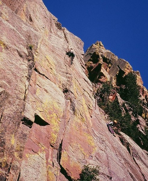 Tony high up in 5.9 territory on Zipcode (5.11-) on Eldo's West Ridge This is well above the crux and is great climbing on great rock with great protection. Photo by Stefanie VanWychen, 3/08.