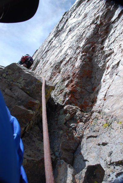 Moving meticulously up the narrow ramp on pitch 3.