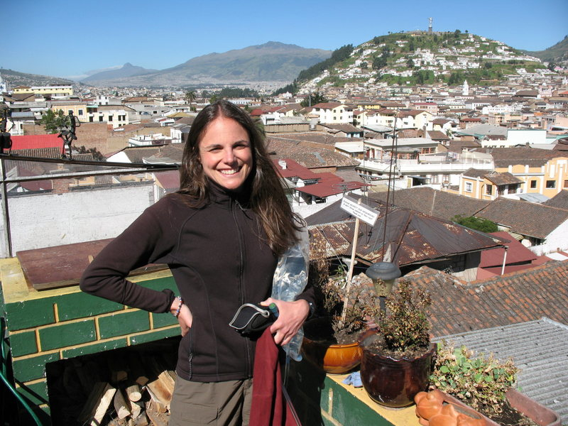 Nancy Bell on the roof of the Secret Garden hostal in Quito. Corazon, near the Illinizas and Cotopaxi, can be seen above her right shoulder, showing Quito's relative proximity to some of Ecuador's most popular peaks.