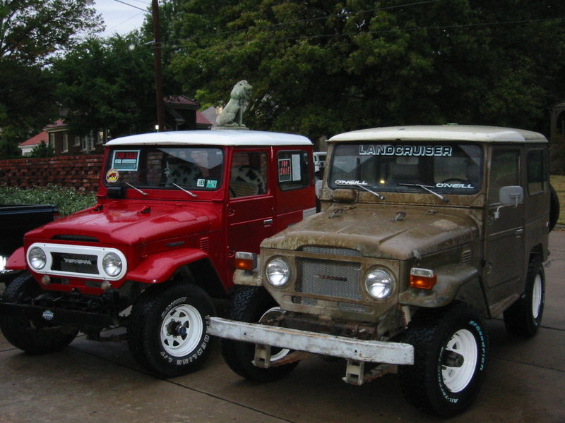 My two landcruisers I bought in high school and college.  Sold the red one to pay for the parts on the olive brown one I was restoring.