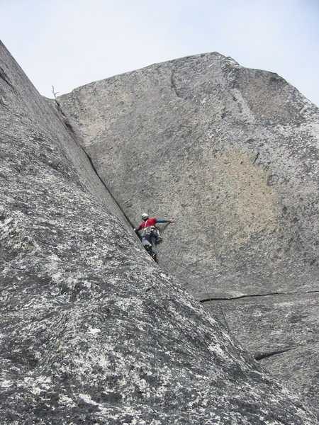 Starting the third pitch corner.  This is where the crack is the widest and the most flared.  Fortunately some stemming, palming and careful pulling on the flared lip of the crack will get you to the bolt.  After the bolt the crack starts to accept more confidence-inspiring gear.