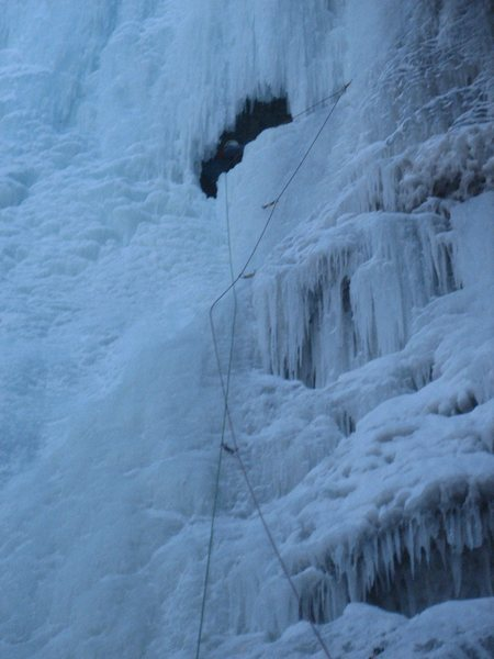 Ice cave at the top of the first pitch. Belay here, or continue on up and right to belay.