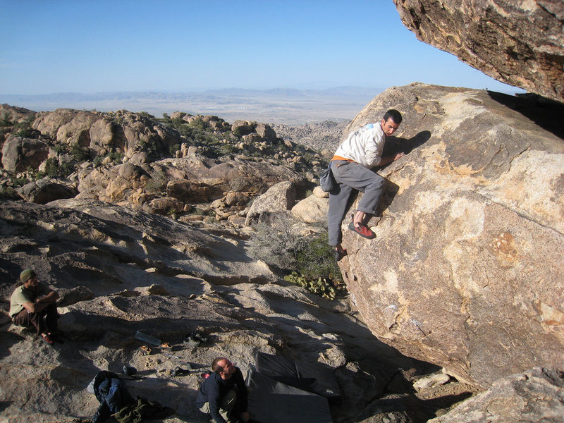 zep topping out some V2 I can't remember the name of on the eclipse boulder.
