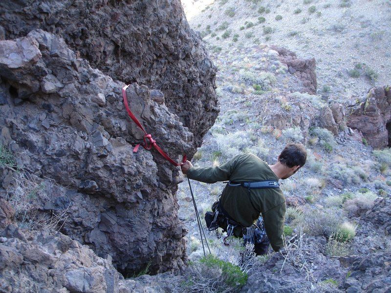 """It's downclimb 30 feet of steep, chossy rock, or rap from this anchor. We rapped, as we brought along a 60 foot rope, and some gear, not knowing beforehand what to really expect as far as the """"climbing section"""" to the summit.<br> <br> We scampered up this section in hiking boots (maybe one or two moves of 5.5 or 5.6 on chossy rock, then scrambled to the summit. A fun little route! The hike to Castle Peaks, and the summit was beautiful; it was all good!<br> <br> Mojave preserve; 4/30/08"""