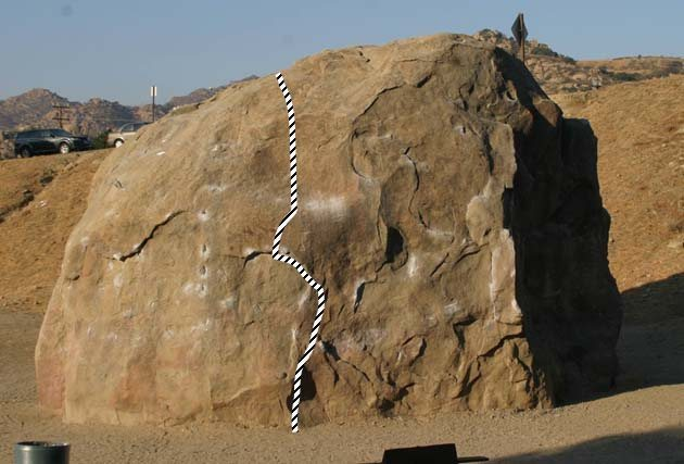 Undercling problem. 5.10c or V0+.  Uses chipped hold to mantel<br> <br> Photo by Chris Owen, I just drew the route in.