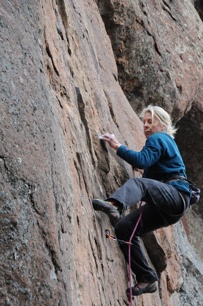 Thin climbing at the fifth bolt.