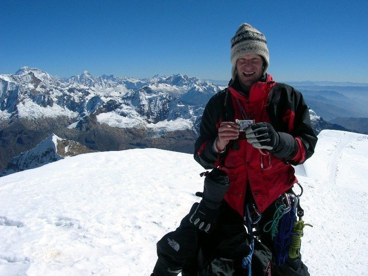 My pal Dale Wagner, on Tocllaraju's summit, with his favorite candy bar.