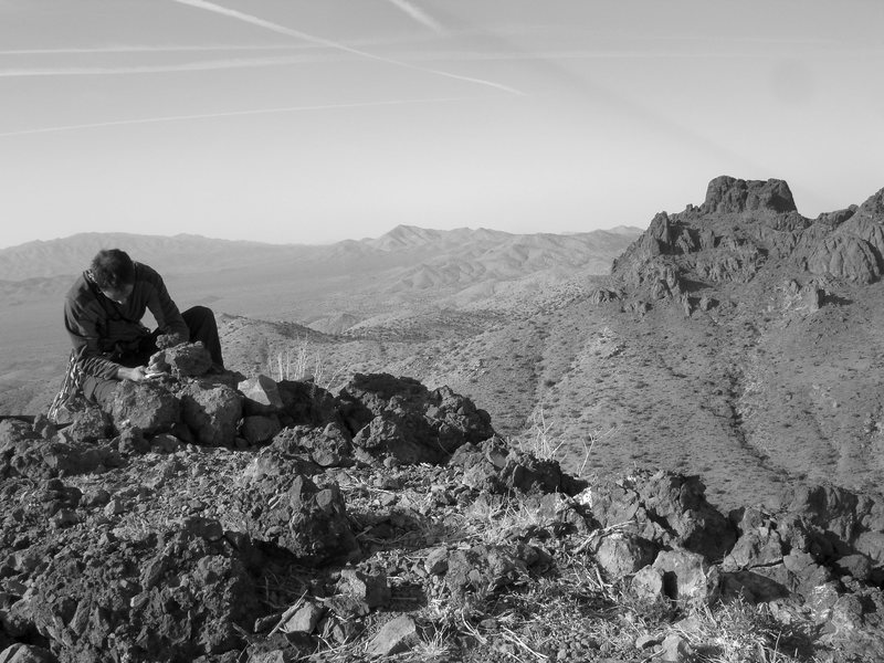 Signing the summit register atop Dove Benchmark. Amazing views await you.