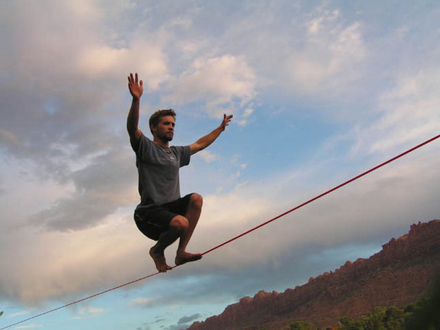Dylan gets tricky in the middle of this 175' slackline.  4th of July 2004.