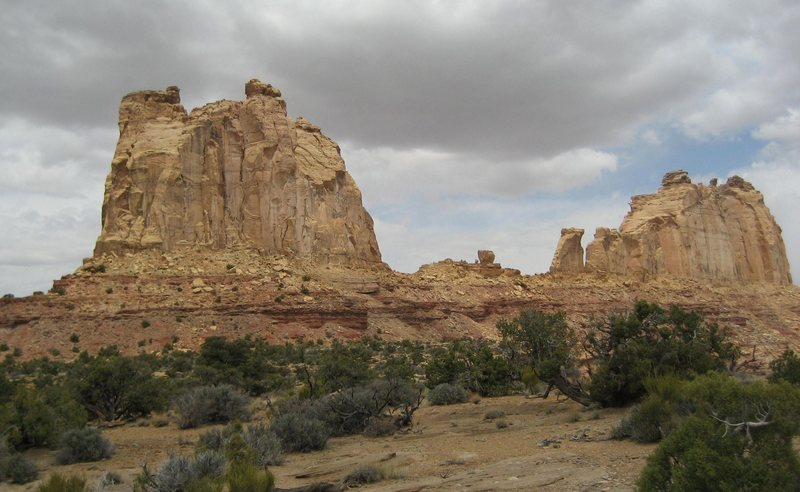 The large formation on the left is The Weasel area,about 500' at its highest point. The small 150'wave like tower in the center is Breezeway, a free 5.9.Th Big formation on the right is The Pinnacle the right end is The Pinnacle Formation,  has several routes,and two smaller towers (out of sight) at its far East end,the Belfry Tower 360' and Sodizin Tower 200'.Much of the rock here is of high quality in spite of its white appearance.The tiny block (50') in the center has been climbed by a crack on its north side at 5.10+