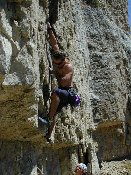 Aaron Mulkey bears down on Rode A Stolen Horse 5.11a at The Bandit Wall.