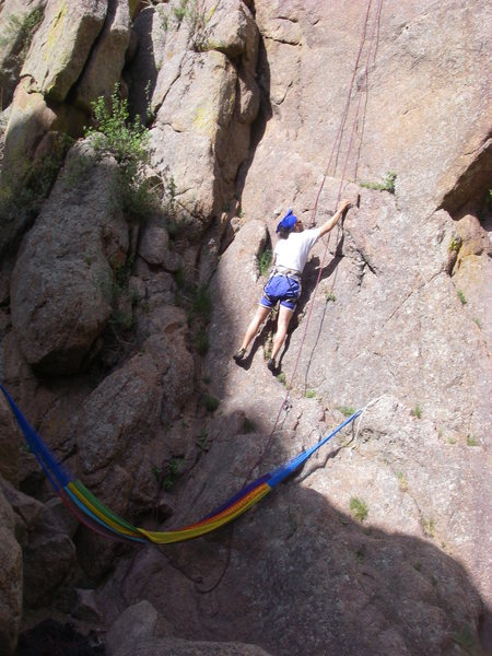 Dave stepping up to the first bolt above the belay/hammock.