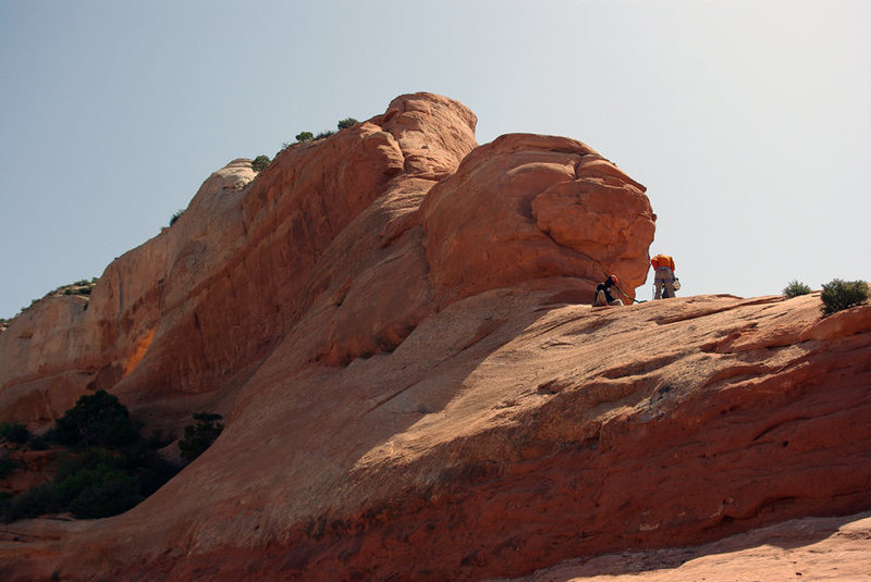 Gearing up to start the climbing on the ridge leading up Wilson Arch. You can see the first two steps that are the 5.3 climbing. The rest is easier slab. Fun, sandy climb. Great rappel. You can just see the arch lit up to the left of center. 5-11-2008