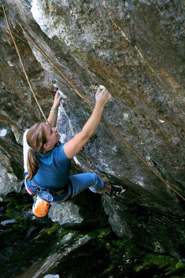 Nadya cranking hard on the moves right before the crux of Stone Monkey